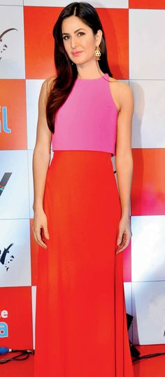 Katrina Kaif in a hot pink and burnt orange gown at a promotional event for #Fitoor. boll