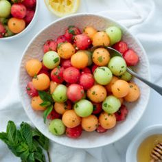 This simple Honey-Mint Melon Salad is a colorful and fresh way to celebrate summer. Best made when melons are at their peak– mushy out-of-season fruit need not apply. #fruitsalad #summer #melonsalad #watermelon #cantaloupe #honeydew #wholefully