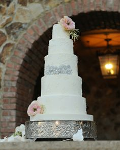 Stunning five tier white lace wedding cake with silver embellishments and pink flowers // Rhodes Studios photography // The Sugar Suite