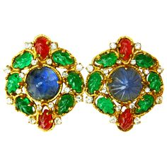 CHANEL Gripoix Round Clip-On Earrings | From a unique collection of vintage clip-on earrings at http://www.1stdibs.com/jewelry/earrings/clip-on-earrings/