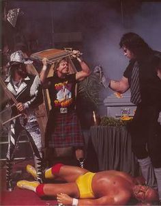 Randy Savage and Roddy Piper protect Hulk Hogan from Undertaker