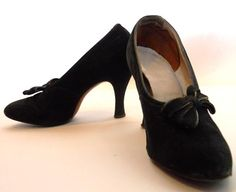 "Late 20s to early 30s black suede heels with off center bows. All leather/suede. Insole reads ""Leather Counters""."