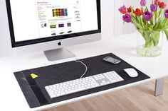 The Desk-Pad classic is the perfect compliment for your iMac or Cinema Display. Simple, elegant and practical, made from felt wool, it requires no additional mouse pad and is fitted with a leather strip down the side for holding business cards or other documents. Available in several colors.