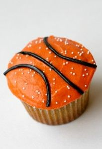 to go along with March Madness date--uses orange food coloring in butter-cream frosting, black licorice, and white nonpareils