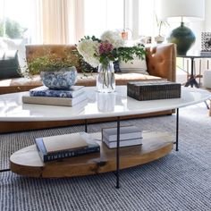 Anchor your living room with this sleek, sophisticated oval coffee table designed by Thomas Bina. The modern steel base and reclaimed French oak shelf below makes for the perfect landing spot for all of your beloved design books. Iron Coffee Table, Oval Coffee Tables, Coffee Table Design, Living Room Interior, Living Room Furniture, Home Furniture, Living Rooms, Oak Shelves, Living Room Decor Traditional