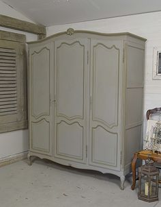 This fantastic 1950s French oak triple wardrobe is painted in Annie Sloan Paris Grey with a lightened version of Olive on the detail. Why not add some elegant French charm to your bedroom! https://www.thetreasuretrove.co.uk/bedroom-storage/vintage-french-louis-xv-style-triple-knock-down-wardrobe #shabbychic #anniesloan #frenchfurniture