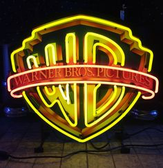 Logo neon with sign 69 x 61 cm. Large Warner Brothers neon with logo sign behind the neon. Warner Brothers Logo, Warner Bros, Neon Sign Art, Vintage Neon Signs, Picture Logo, Picture Wall, Neon Logo, Hollywood Sign, Neon Light Signs