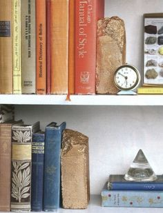 Paint old chipped bricks gold and use them as book ends.