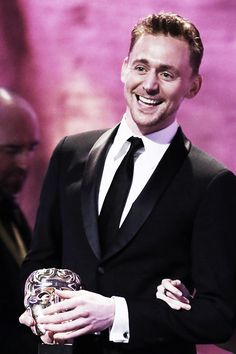 Tom Hiddleston on stage to present the Production Design Award at The EE British Academy Film Awards 2013 at The Royal Opera House on February 10, 2013 in London, England