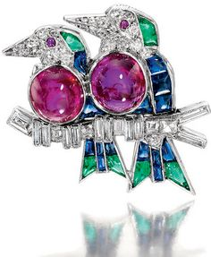 EMERALD, SAPPHIRE, RUBY AND DIAMOND BROOCH, CARTIER, CIRCA 1920  Designed as a pair of love birds perched on a branch, set with cabochon rubies, calibré-cut buff-top sapphires and emeralds and French-, single-, square-cut and baguette diamonds, signed Cartier London and numbered.