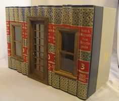 http://www.shannonsminis.com/11-12/F.jpg Great site...buildings out of books