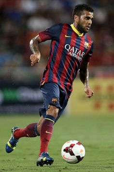 Dani Alves #22 of Barcelona makes a break against Thailand XI during the international friendly match between Thailand XI and FC Barcelona at Rajamangala Stadium on August 7, 2013 in Bangkok, Thailand.