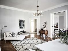 Elegant Scandinavian apartment with dreamy details - Beni Ourain Rug - Kartell Ghost Chairs - IKEA Söderhamn Recamiere