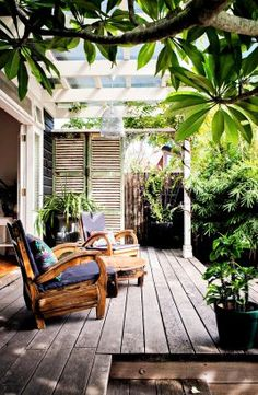 For the under-utilised west-facing garden, a landscape gardener suggested installing French doors off the bedroom opening onto a deck. Installing French Doors, West Facing Garden, Outdoor Rooms, Outdoor Decor, Outdoor Furniture, Outdoor Patios, Deck Patio, Outdoor Kitchens, Concrete Patio