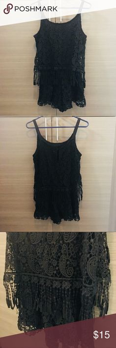 Black Crochet Romper This is really cute black crochet material romper with tags still on from No Rest for Bridget in Newport Beach! The top layer sort of falls over the shorts so it's super flattering even if it's tight. Hoping to get this to someone who will love it and get some great use out of it in the summertime! Pants Jumpsuits & Rompers