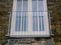 Metal balconies made in Cornwall with wrought iron railings or stainless steel and glass balustrades. Juliette Balcony, Stainless Steel Railing, Glass Balustrade, Balcony Railing, Glass Panels, Wrought Iron, Blinds, Loft, Exterior