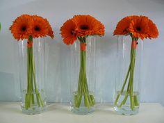 Simple orange gerbera wedding centrepieces