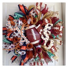 University of Virginia & Florida State house divided football wreath. Follow Created By Terri/Crafts & Creations By Terri facebook.com/CraftsandCreationsByTerri  www.etsy.com/shop/CreatedByTerri instagram.com/createdbyterri Twitter @ designsbyterri