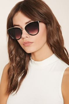 A pair of cat eye sunglasses featuring metallic trim and gradient lenses.