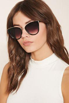 A pair of cat eye sunglasses featuring metallic trim and gradient lenses.