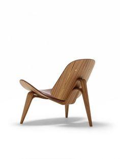Hans Wegner's CH07 wooden shell chair.