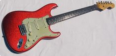 1963 Fender Stratocaster Factory Sparkle Red, This is not a reissue, custom shop, reproduction, clone or refinish. This is a RARE Fender Factory Sparkle Red made in 1963. This is the rarest of all