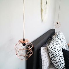 The Kmart copper geo candle holder repurposed as a light fitting