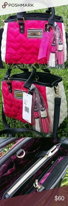 """Betsey Heart Quilted Crossbody Bag Hot Pink Black The most gorgeous Betsey Crossbody Bag around!   Bright How pink with cream and black accents,  golden hardware,  heart quilted,  striped logo plaque,  two big tassels bag Keychains / charms detachable & adjustable strap.   Just in love with this bag!   Brand new with tags MSRP $88 plus tax   Measurements: 11"""" x 8"""" x 5"""" Betsey Johnson Bags Crossbody Bags"""