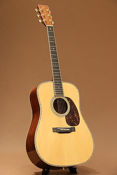 Martin D-45 Conversion (2010) : Converted at Martin Custom Shop from a 1969 D-28. Adirondack Spruce top, Brazilian Rosewood back & sides. Scalloped bracing.