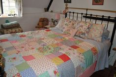 1930's reproduction cotton quilt incorporating Cath K prints, made by Hen House