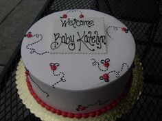 Little Ladybugs...flittering about.  Cute baby shower cake.