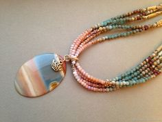 Check out this use of colors in the beads to repeat the pattern in the pendant.