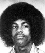"""Before graduating high school, Prince was already busy co-writing songs and recording guitar tracks for his cousin's band """"94 East."""" He's pictured here in his sophomore year photo from Central High School in Minneapolis in 1974."""