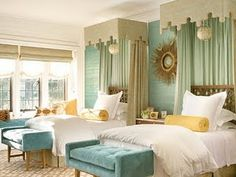 brass and aqua. Love the pelmets over the bed too, talk about a great way to jazz up a guest room!
