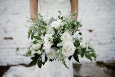 Ivory and green wedding bouquet  | A Romantic Uptown Wedding Full of Personal Touches and Sweet Details -- Bustld -- Planning Your Wedding Just Got Easier | Charlotte NC wedding, Charlotte Bride, NC wedding, modern uptown wedding, metallic colors, ivory and green wedding | Planner @somethingperf Venue @themintmuseum Catering @karedteed Florals @lilygreenthumbs  Beauty @beautyasylum Rental @partyreflection