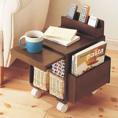 Cute side table  with storage - a pull-out shelf, remote control holder, magazine holder and on wheels! Great lounge / living room accessory.