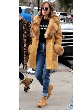 Who: Dakota Johnson What: A Suede and Shearling Coat Why: Nothing says mountain chic quite like a suede and fur lined coat—as evidenced by Johnson in snowy Aspen for the holidays. Get the look now: Gucci coat, $4,750, net-a-porter.com.    - HarpersBAZAAR.com