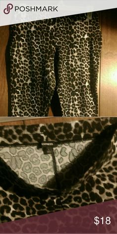 Express Leopard Capri Leggings Large EUC For your viewing pleasure is this great pair of Express brand capri length leggings in size large.  Excellent preowned condition. Express Pants Leggings