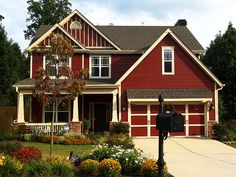 B wants to paint our red house another color, but I like this red house and trim