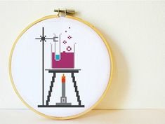Multi-buy special: Get a 4th Pattern for FREE!! To order put 4 patterns in your cart and enter the code FreePattern at checkout. Your total will be automatically adjusted. :)     A chemistry experiment ready to stitch for all science fans. This pattern includes great nerdy details in the set up - bunsen burner, tripod, stand, clamp, wire gauze, beaker and test tube. Its a pattern that looks great in any mix of colours so you can change the colours of the chemicals easily to match to any room…