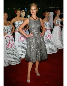 Katherine Heigl In a silver sequined dress by Bill Blass, Heigl poses in front of 27 models dressed for her film 27 Dresses. Read more: Katherine Heigl Images - Red Carpet Photos of Katherine Heigl - Harper's BAZAAR  Follow us: @Kerry Pieri on Twitter   HarpersBazaar on Facebook  Visit us at HarpersBAZAAR.com