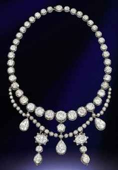 AN ANTIQUE DIAMOND NECKLACE The rivière designed as a graduated line of forty old-cut diamond collets with detachable diamond swags suspending a series of pear and cushion-shaped diamond pendants, two drops may be worn as earrings, mounted in silver and gold, circa 1870, 40.5cm long, in purple velvet fitted case by Garrard & Co. [Sold for 2.9 million USD]
