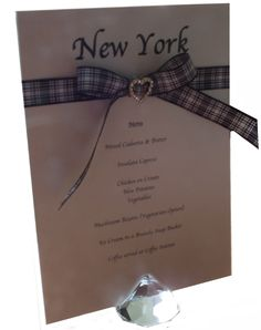 Combined wedding Table Name Card and Menu on Candlelight Cream card with Menzies tartan ribbon and a gold toned diamante heart ribbon slide. www.lilguy.co.uk