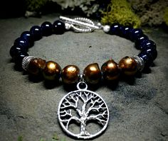 A personal favorite from my Etsy shop https://www.etsy.com/listing/233932044/tree-of-life-charm-bracelet-bronze