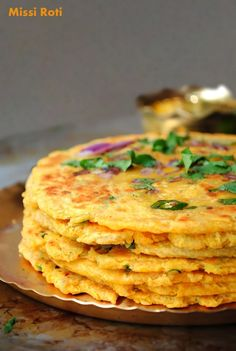 Spicy Indian flat bread made with chickpea flour topped with cilantro and onions. Makes for a great healthy snack and goes with any curry.