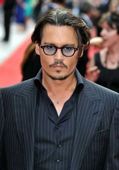 ae958355f0 Depp is sporting these ultra elegant Ton Ford. Celebrity Sunglasses Watcher