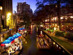A major attraction in San Antonio, the River Walk's shops and restaurants draw throngs of visitors. [Photo by Wesley Hitt, Photolibrary]