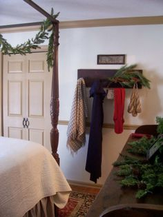 Colonial style adornments of swags and garlands of greenery.