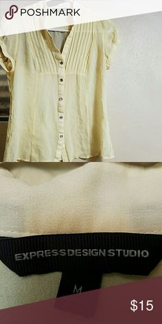 Express 100% silk shirt size M 100% silk Butter cup yellow Cute silver buttons down the front and on the sleeves Express Tops Button Down Shirts