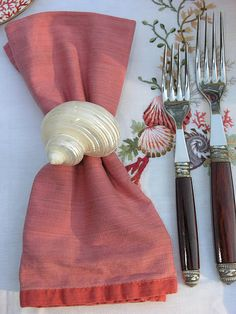 i could hot glue a seashell to a napkin ring for a nice touch to the table setting.